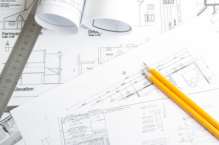 Construction planning drawings on the table and two yellow pencils Stock Photo