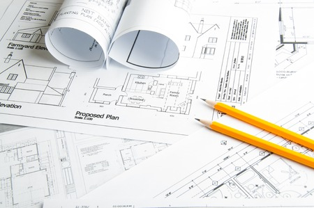 architect plans: Construction planning drawings on the table and two yellow pencils Stock Photo