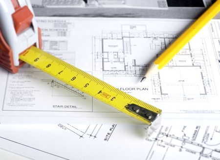 home construction: Construction planning drawings on the table and two yellow pencils Stock Photo
