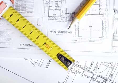 architecture plans: Construction planning drawings on the table and two yellow pencils Stock Photo