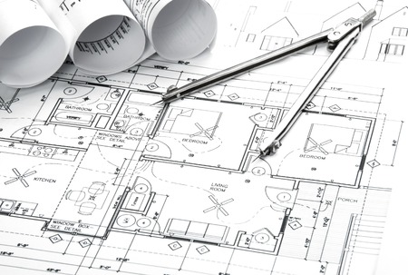 building blueprint: Construction planning drawings on the table and two yellow pencils Stock Photo