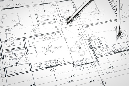 house blueprint: Construction planning drawings on the table and two yellow pencils Stock Photo