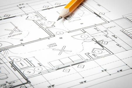 Construction planning drawings on the table and two yellow pencils Foto de archivo
