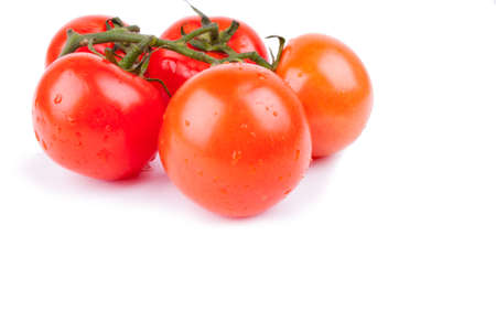 Bunch  of red cherry tomatos isolated on the white background Stock Photo