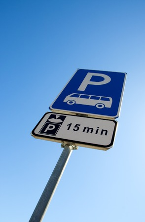 bus parking: bus parking and limit time, blue and white road  signs on blue sky background Stock Photo