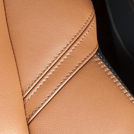 Orange car leather interior texture with stitch