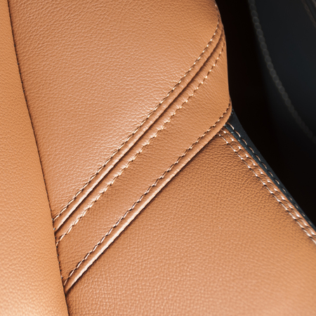 Orange car leather interior texture with stitch