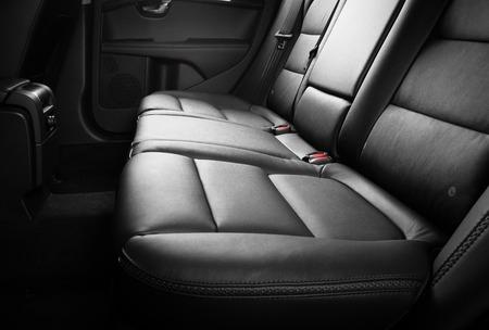Modern car interior black leather back seats Archivio Fotografico