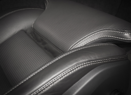 car seat: Black pefrorated leather new sport car seat Stock Photo