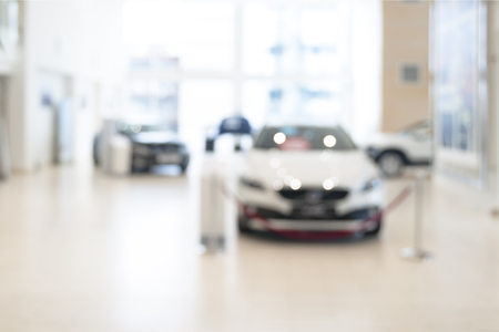 Abstract blurred photo of motor showroom, car show room, blur color