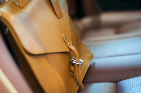 leather briefcase: Brown leather briefcase on the car back seat