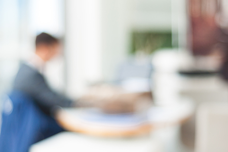 open plan office: blurred office background , office worker at the computer, working day Stock Photo