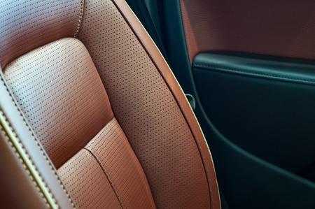 Brown red pefrorated leather new sport car seat Archivio Fotografico