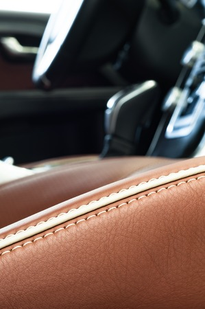 leather: Brand new business car interior in  brown leather and chrome, leather stitch focus