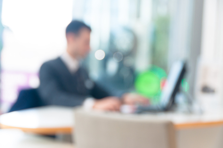 blurred office background , office worker at the computer, working day Stockfoto