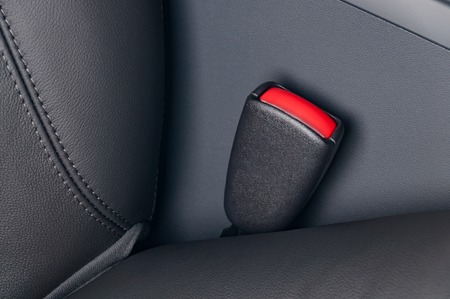 drive safely: Seat belt fastener lock in black leather interior