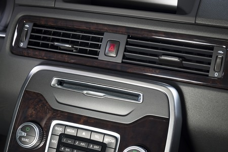 car air-condition register in modern interior with wood
