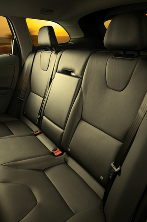 suede belt: back passenger seats in modern luxury comfortable car Stock Photo