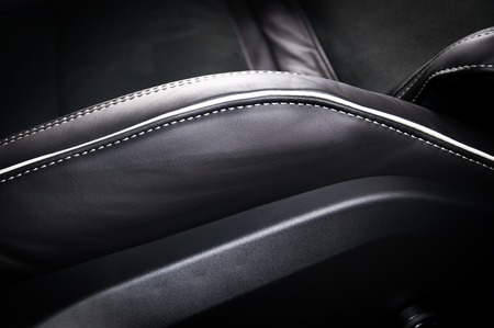 car seat: Leather car seats. Interior detail. Seam focused