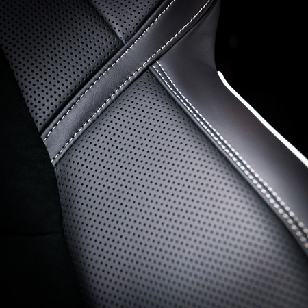 leather belt: Leather car seats. Interior detail. Seam focused