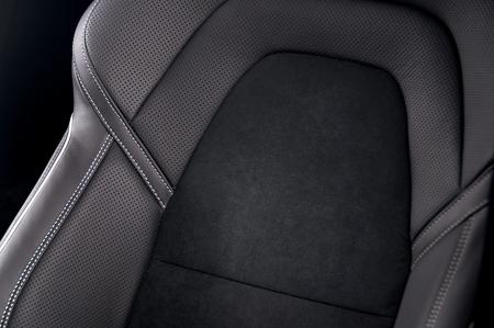 headrest: Leather car seats. Interior detail. Seam focused