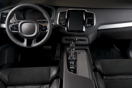Modern car interior, front view, black colors and dark light Archivio Fotografico