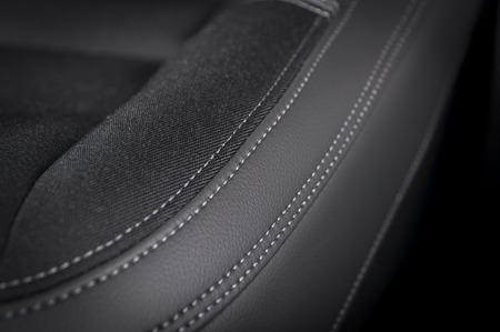 suede belt: Leather  car seats. Interior detail with stitch