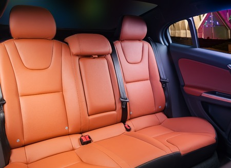legroom: Car interior, back seats with night city in the windows