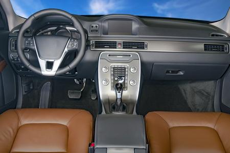 shift: Dark luxury car Interior - steering wheel, shift lever and dashboard