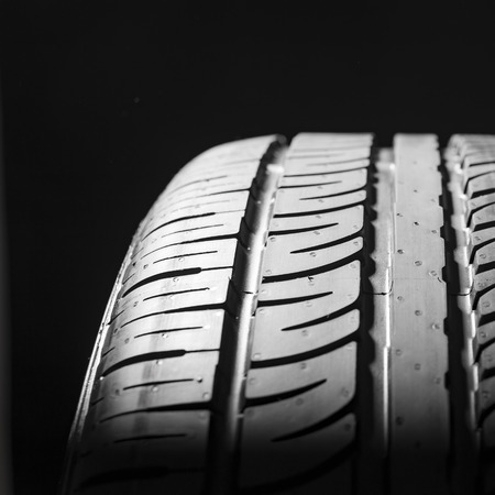 treads: Car tires close-up wheel profile structure on black background