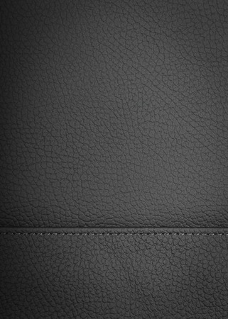 Black natural leather background or texture close up
