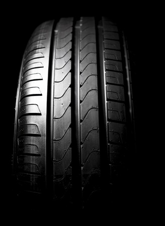 winter tires: Car tires close-up Winter wheel profile structure on black background