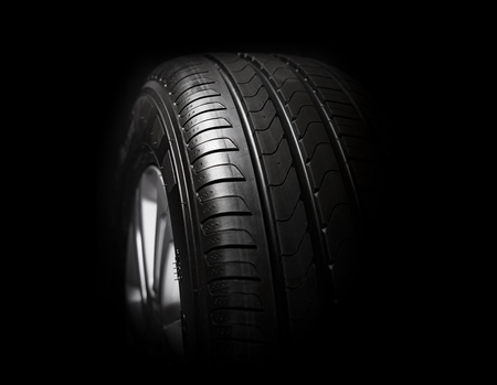 treads: Car tires close-up Winter wheel profile structure on black background
