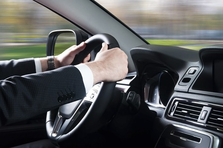 private parts: transport, business trip, speed, destination and people concept - close up of young man driving car