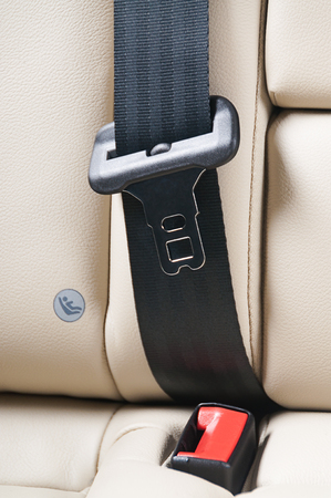 warning back: seat belt on a leather chair in modern car interior Stock Photo