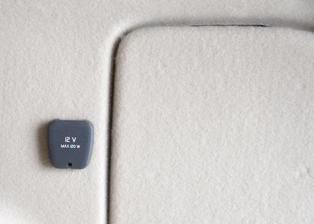 12v: 12V power outlet socket in a car