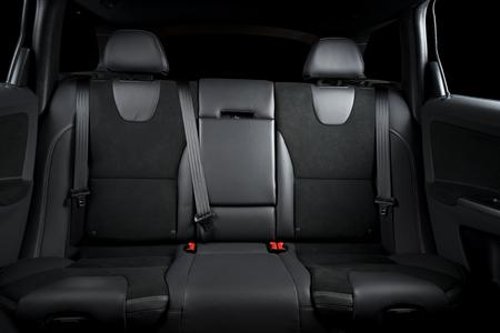 legroom: Back passenger seats in modern luxury car, black upholstery Stock Photo