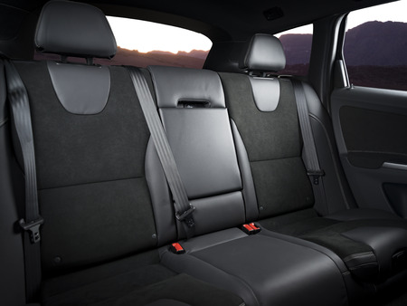legroom: Back passenger seats in modern luxury car with sunset in the windows