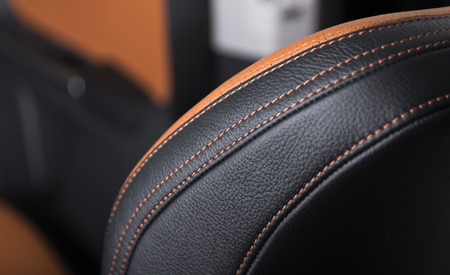 Modern sport car  black leather interior. Part of  leather car seat details. 免版税图像