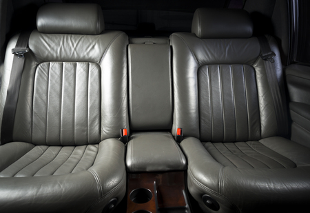 legroom: Back passenger seats in rertro luxury car, frontal view, black leather