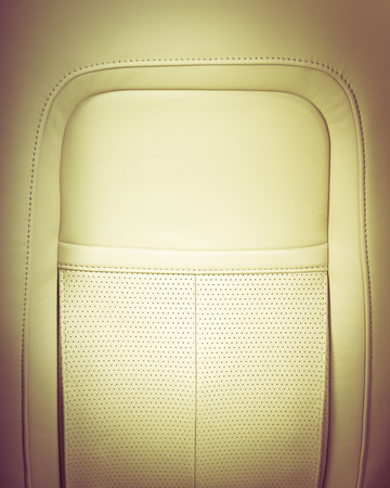 legroom: Back passenger seats in modern luxury car, frontal view, white leather