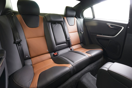 legroom: Back passenger seats in modern luxury car, frontal view,
