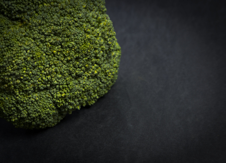 Green fresh broccoli over dark surface. Studio shot Archivio Fotografico