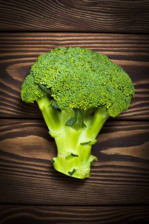 Green fresh broccoli on rustic wood background. Studio shot Archivio Fotografico