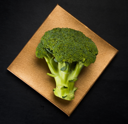 Green fresh broccoli on a dark surface. Studio shot
