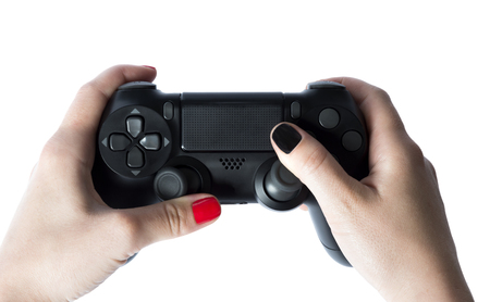 Video game console controller in gamer hands. Game controller in hand isolated on white background. Archivio Fotografico