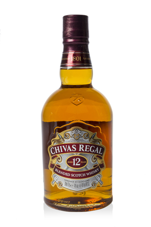 Saint-Petersburg, Russia - 26 August 2017: Studio shot of a bottle of Chivas Regal on white background, 12 years old scotch whiskey.Chivas Regal is a blended Scotch whisky produced by Chivas Brothers, owned by Pernod Ricard. Editoriali