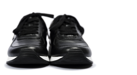 Black sneakers isolated on white background