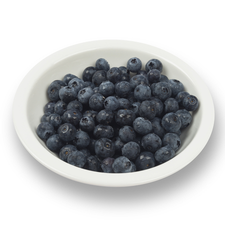 Blueberries on the white plate isolated on white including clipping path