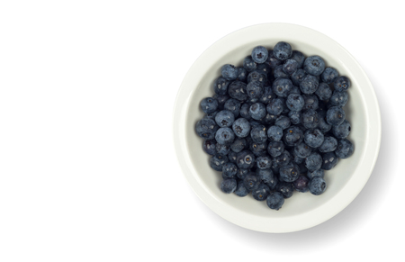 Blueberries on the white plate isolated on white  background including clipping path and copy space